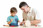 Father and son make nesting box together