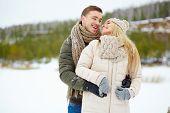 Amorous dates in winterwear enjoying spending time outside