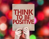 Think To Be Positive written on colorful background with defocused lights