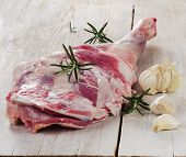 Raw Lamb Leg On  Wooden Cutting Board.