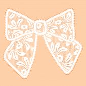 Decorative White Lacy Bow On Beige Background