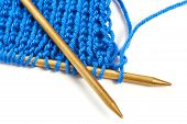 Two Spokes With Knit Blue Woolen Cloth Isolated Macro