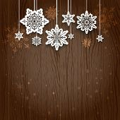Dangling snowflakes and place for your congratulations. Holiday background.