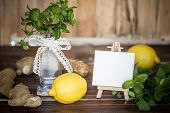 Mint, Lemons, Ginger And Mini Easel With Blank Canvas