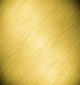 Abstract texture of dark yellow, golden and light black smooth brushed metal background