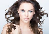 Beautiful Brunette Woman Portrait with healthy Hair.