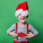 Funny little boy with Santa Claus hat laugh. Christmas concept