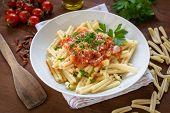stock photo of italian parsley  - dish of italian pasta topped with tomato sauce and parsley - JPG