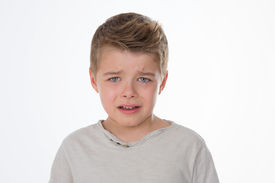 stock photo of saddening  - young kid with sad eyes and expression - JPG