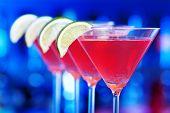 image of cosmopolitan  - Four Cosmopolitan cocktails shot on a bar counter - JPG