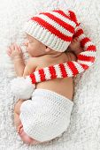 foto of christmas baby  - Newborn baby wearing a knitted Christmas elf hat - JPG