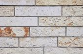 stock photo of tile cladding  - New stone cladding plates on wall closeup - JPG