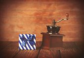 image of wooden box from coffee mill  - Coffee gringer and gift box on wooden table - JPG