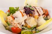 stock photo of caesar salad  - tasty fresh caesar salad with grilled chicken parmesan and croutons - JPG