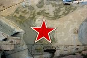 image of military helicopter  - A red Russian Star on the side of an old military helicopter - JPG