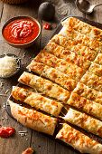 picture of dipping  - Homemade Cheesy Breadsticks with Marinara Sauce for Dipping - JPG