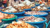 pic of fresh water fish  - Traditional asian fish market stall full of fresh seafood