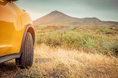 image of paysage  - Yellow car on a background of mountains - JPG