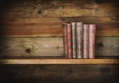 stock photo of book-shelf  - grunge wooden shelf with old books - JPG