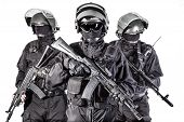 stock photo of anti-terrorism  - Russian special forces operators in black uniform and bulletproof helmets - JPG