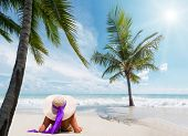 foto of beach hat  - Beautiful woman on the beach with straw hat on the beach in Bali Indonesia - JPG