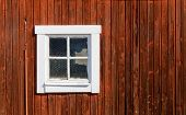 stock photo of red barn  - Red traditional barn wall and an old window - JPG