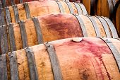 stock photo of wine cellar  - American oak barrels with red wine - JPG