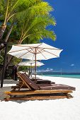pic of boracay  - Sun umbrellas and beach chairs on a beautiful island Philippines Boracay - JPG