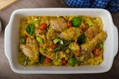 picture of curry chicken  - Roasted chicken quarters with curry vegetables cauliflower tomatoes and leek - JPG