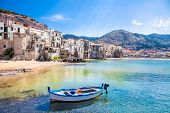 foto of old boat  - Beautiful old harbor with wooden fishing boat in Cefalu - JPG