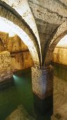 picture of underground water  - Old historical underground water well in medieval environment - JPG