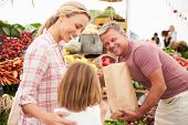 picture of farmers market vegetables  - Family Buying Fresh Vegetables At Farmers Market Stall - JPG