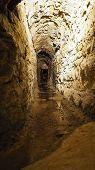 stock photo of underground water  - Old historical underground stream sewer in medieval environment - JPG