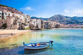 picture of boat  - Beautiful old harbor with wooden fishing boat in Cefalu - JPG