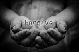 pic of forgiveness  - Forgive text is in the holding hands with dark corners - JPG
