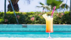 picture of cinderella  - Glass of Cinderella kids cocktail on the pool nosing at the tropical resort - JPG