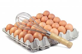 stock photo of chicken-wire  - Whisk and Fresh Chicken Egg in carton on white background - JPG