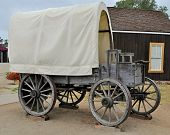 stock photo of covered wagon  - A classic Covered Wagon replica on display - JPG