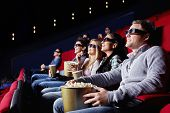 stock photo of watching movie  - Young attractive people watch movies in cinema - JPG