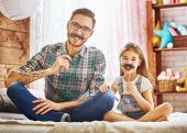 Happy fathers day! Dad and his child daughter are playing and having fun together. Beautiful funny  poster