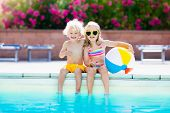 Kids Playing At Outdoor Swimming Pool poster