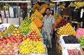 CHENNAI, INDIA - CIRCA MAY 2009 : A fruit vendor sells all sorts of exotic tropical fruits circa May