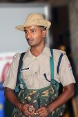 CHENNAI, INDIA - AUG: 22: An Indian security gusard posted at a train station in Chennai, India,  to