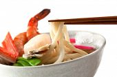 Seafood Udon Noodle Soup, Popular Japanese Dish, with shrimp, crabmeat, scallop, fish cake, snow peas, mushrooms in broth
