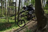 downhill with a mountain bike at forest