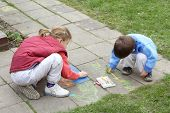 Kids chalk picture painting chalk picture on concrete