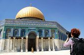 Photographer taking picture of famous Dome of the Rock on Temple Mount in Western Jerusalem, Israel.