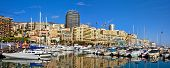 Panoramic view on marina with yachts and residential buildings in Monte Carlo, Monaco.