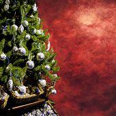 christmas tree with decorations on square red grungy background to use as card