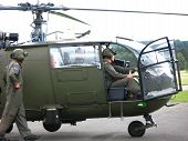 Military Helicopter On The Airfield